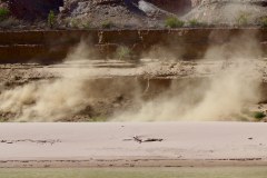 Sand cascading off the silt walls, and blowing upstream.