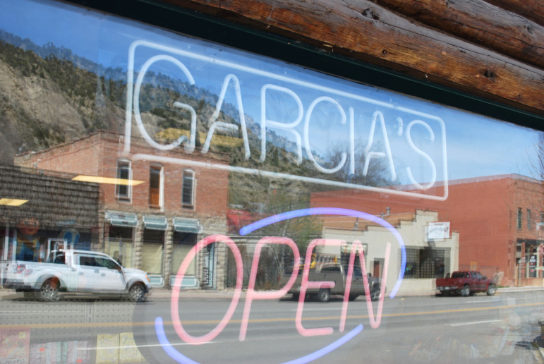 The sign for Garcia's market looks out over Main Street in New Castle, where the 2010 census shows the Hispanic population has grown five times larger in the past 10 years.