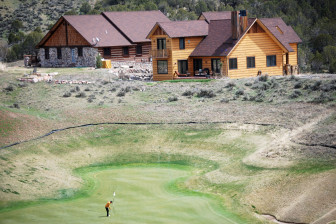 A golfer putts at a hole in Lakota Canyon Ranch, a golf course development that helped redefine New Castle  and made it a magnet for people who worked upvalley and downvalley.