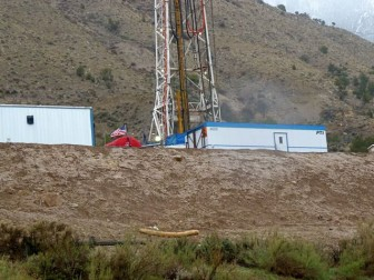 A gas rig in the Parachute Creek watershed. Large bare walls of dirt are a common site on the sides of rig platforms.