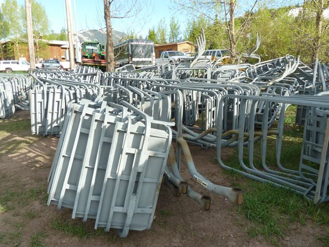 Chairs from the Tiehack lifts stacked at the Buttermilk base area. The SkiCo is still working on a plan for the chairs. SkiCo plans to recycle most of the other metal from the two old chairlifts.