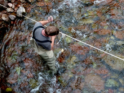A technician from the city of Aspen using a device to measure streamflow in Maroon Creek in summer 2010. Much of the debate over Aspen's hydro proposal comes down to how much water will be left in Maroon and Castle creeks, and when.