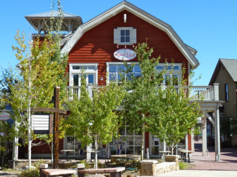 "Meant to evoke the ranching heritage of the Brush Creek valley, the red ""Sweet Life"" building sits at the center of Base Village."