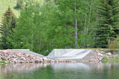 The new spillway on the east dam on Thomas Reservoir. The trees in the background will be cut down and the roots excavated.