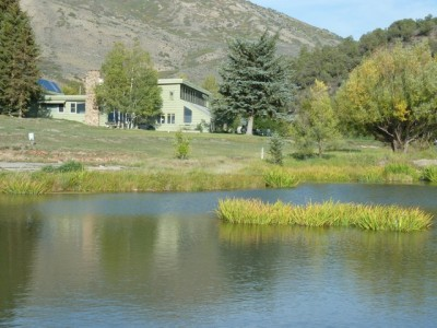 Behind the pond is the 1952 ranch house, with the original stone chimney, that has served as a monk's retreat. Formerly, it was the Windstar demonstration building; currently, it serves as RMI's office building.