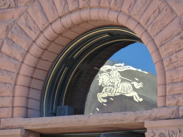 A window in the Cowenhoven building, which holds down an iconic corner in downtown Aspen. Now home to a Burberry knight.