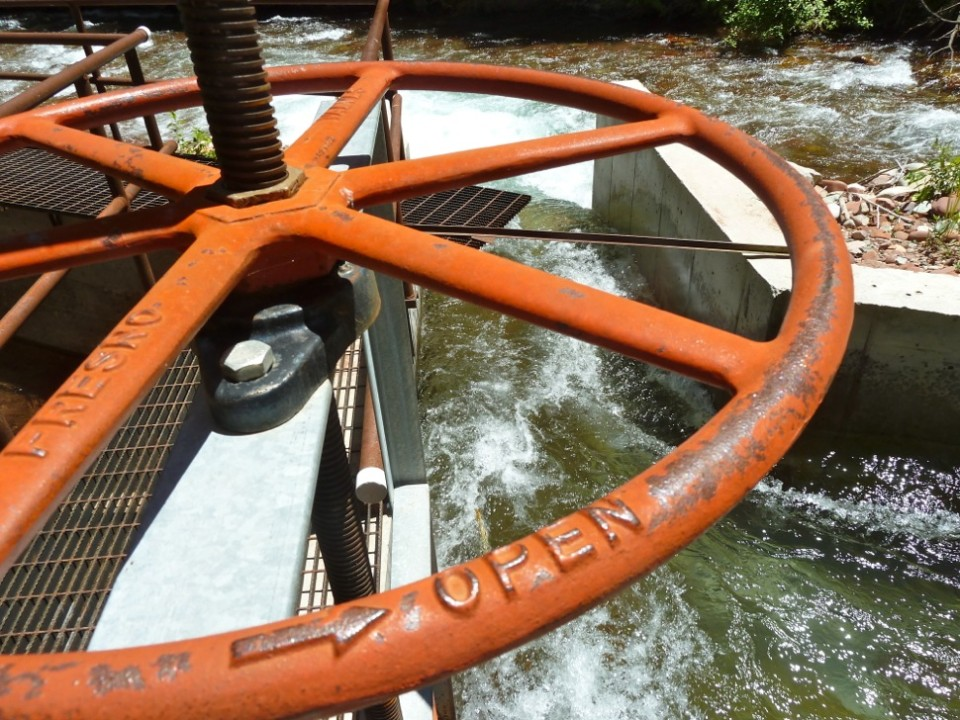 A wheel on the headgate that raises or lowers the opening for water to flow into the ditch. The county prefers the opening to be smaller, not larger.