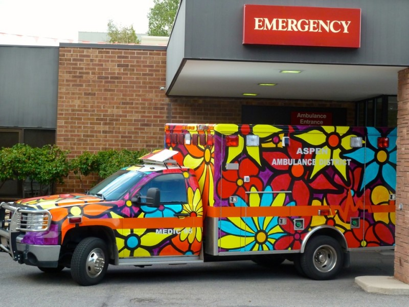 Sometimes there is time to shop for health care. Sometimes not. A brightly-colored ambulance outside of the Aspen Valley Hospital emergency room over the busy Labor Day weekend in Aspen.