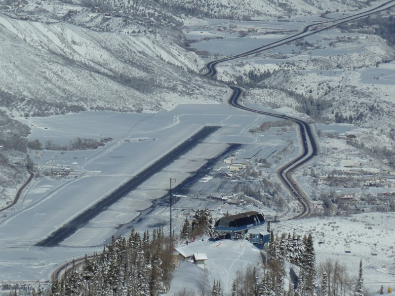 A view of the Aspen airport runway from Aspen Mountain, earlier this winter. The top of the Ruthie's chairlift is in the foreground.
