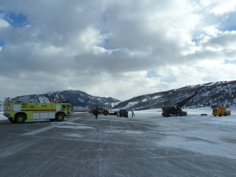 Emergency vehicles on the runway at Aspen today, Sunday, Jan. 5, 2014.