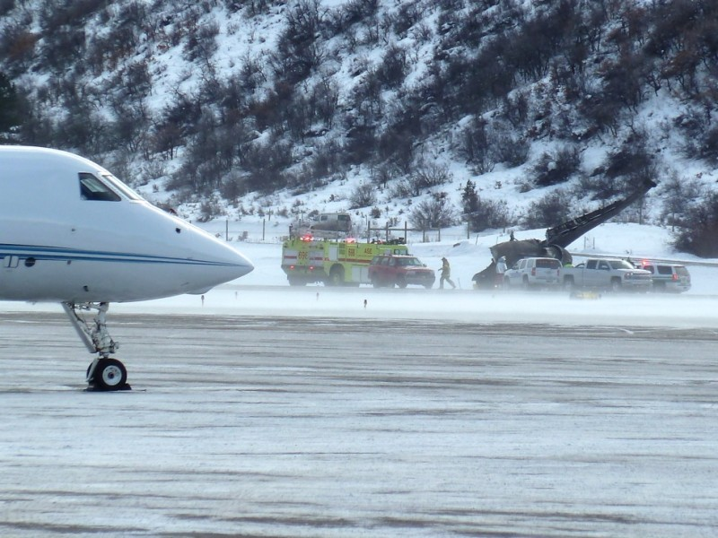 A view from across the Aspen runway of the wrecked jet on Sunday, Jan. 5, 2014. Wind-driven snow is blowing across the runway.