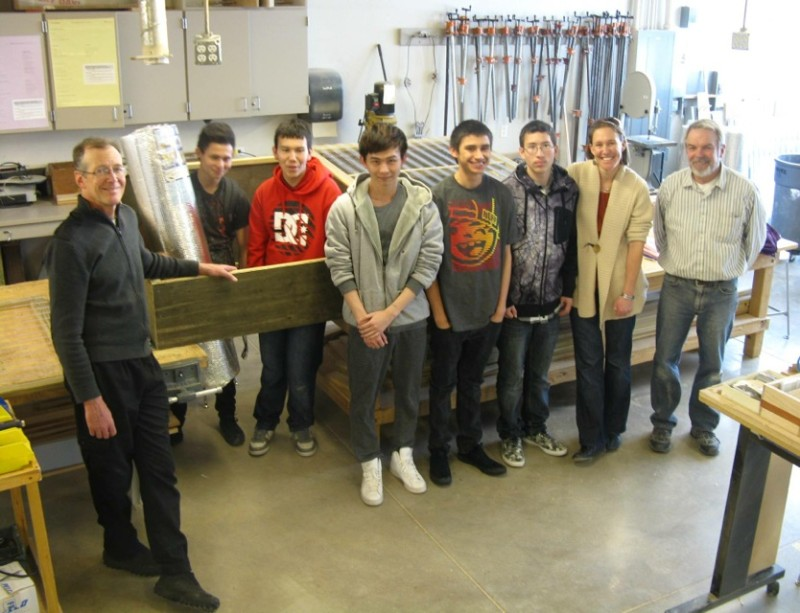 Basalt High students are building cold frames with help from architect Michael Thompson (left), Rachel Conner of (co)studio (2nd from left), and wood shop teacher Eric Pedersen (right).