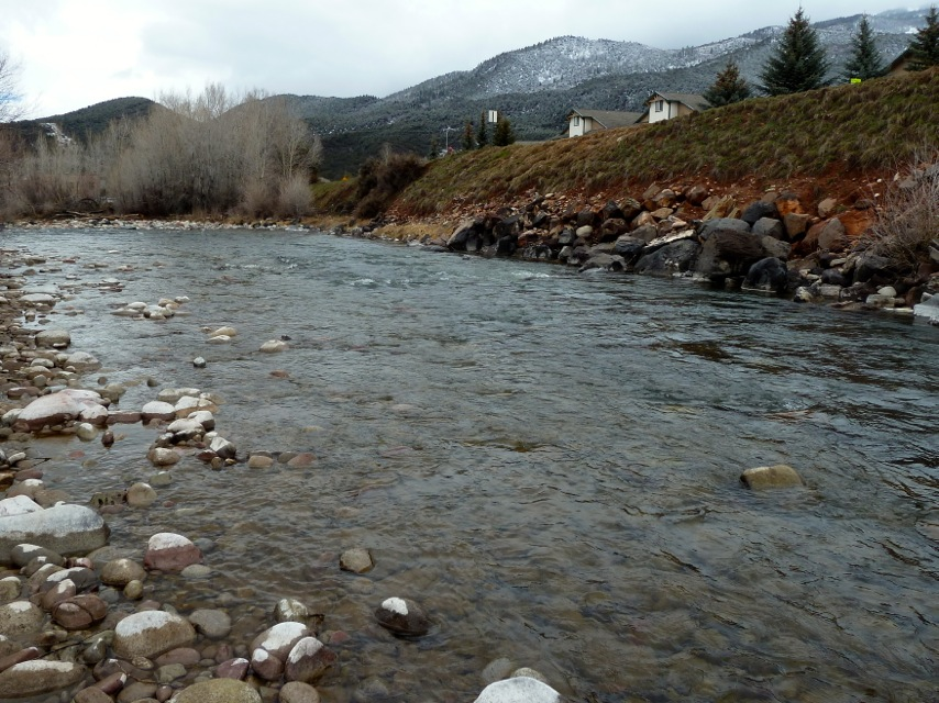View looking downstream of the proposed location of the Pitkin County Whitewater Park in the Roaring Fork River, beneath Two Rivers Road in Basalt.