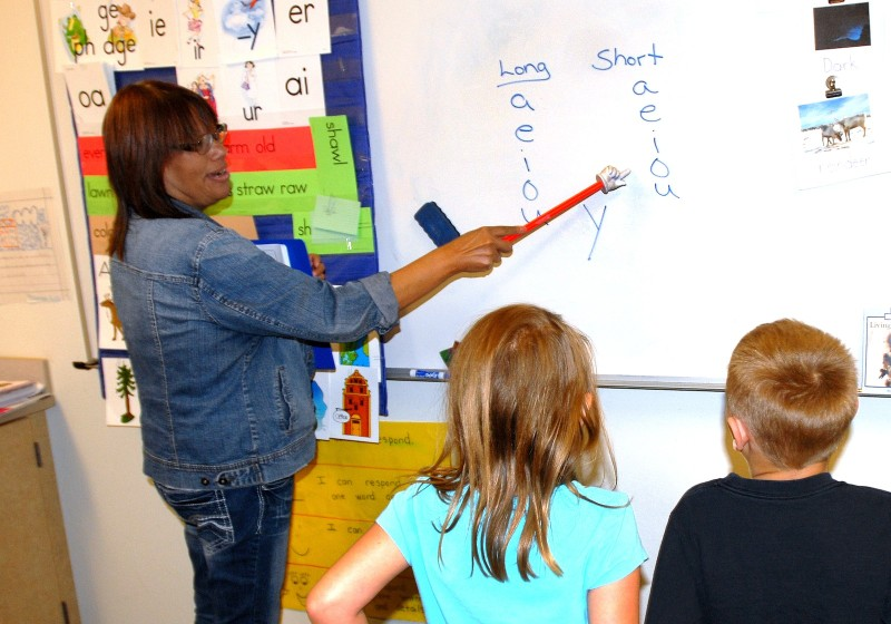 Students at Cactus Valley Elementary in Silt practice sounding the vowels with paraprofessional Julie Sands.