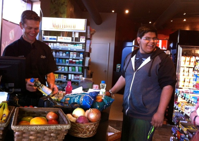 Humberto Sandoval of Snowmass Village jokes with store director Trevor Moodie at the Clark's Express in Base Village.