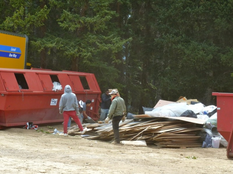 Workers sort through a large pile of trash at the Little Annie wedding site, on Monday, June 16.
