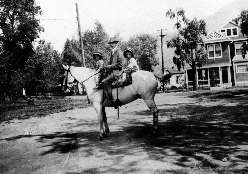 Fletcher Brown, David R.C. Brown and Darcy Brown ride by the house  at 206 Lake Ave. once owned by Judge Shaw' in this photograph from 1918.