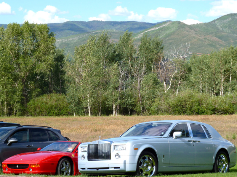 Aptly, a Rolls was the first car parked at the Romney fundraiser at Susan Crown's house in July 2012.