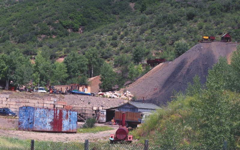 Pitkin County commissioners are considering an application that would see the historic Smuggler Mine developed as a tourist attraction with two large homes built above and to the left of the mine.
