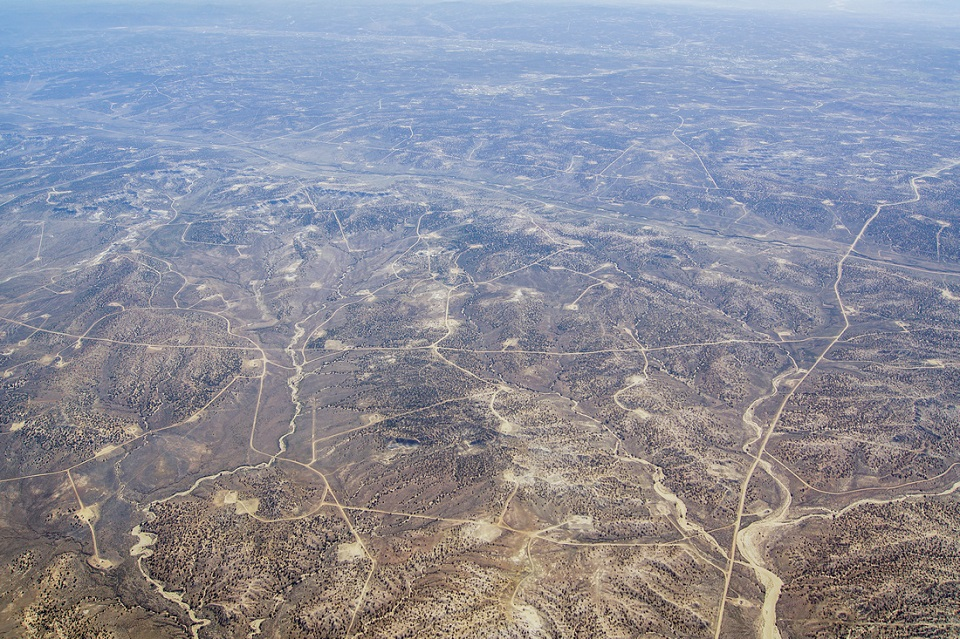 Roads and drill pads mar the once empty mesas of New Mexico where only Chacoan roads crossed over a thousand years ago.