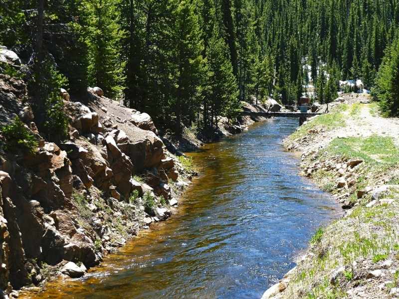 A diversion ditch sending water toward the eastern slope of Colorado.
