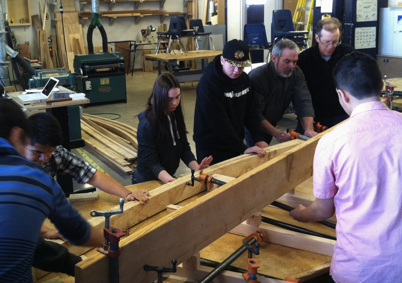 Teachers and students work together in the Basalt High School woodshop to bend the future ribs of their greenhouse, which will end up at the Basalt Middle School garden. Left to right are Alfredo Lopez, Emiley Weinreis, Jose Arias, former woodshop teacher Eric Pedersen and Basalt architect Michael Thompson.