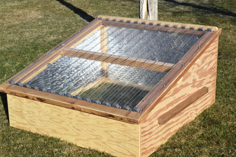 "Before starting on a greenhouse, the (co)studio class built a number of ""cold frames,"" miniature greenhouses that enable gardeners to protect young plants from early-season frosts. By selling the cold frames, the class is raising the cash to buy the greenhouse materials."