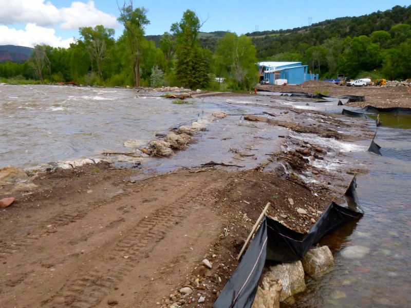 The river, as designed, was flowing over the stones placed along the bank of the Roaring Fork River in Basalt on the site of the old trailer park. An engineer with the town of Basalt said high water was always expected to rise up and over the recently-placed rocks, but there was concerns Friday that the water take away topsoil that was about to planted - before the high water came.