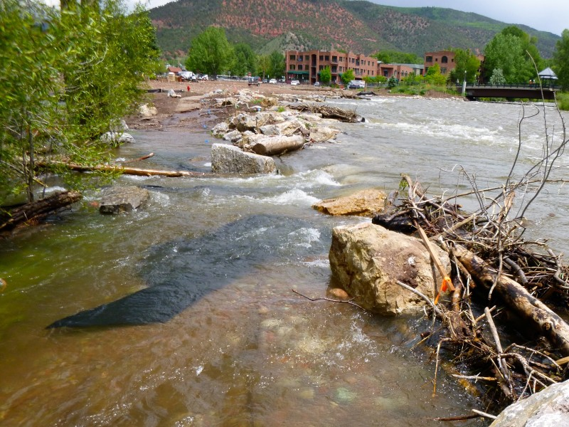 Looking up the Roaring Fork River Monday toward Basalt where the river has over topped rocks placed along the river bank last fall. The rocks were designed to let the river flow over them, but not in a such a concentrated flow as had developed by Monday afternoon.