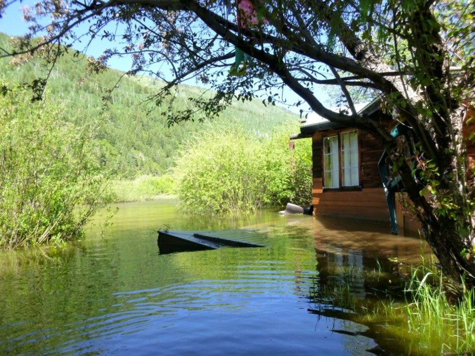 A cabin dating to the mid-1960s in the Stillwater section of the Roaring Fork River was flooded Wednesday, with standing water in the living room and in a nearby art studio.