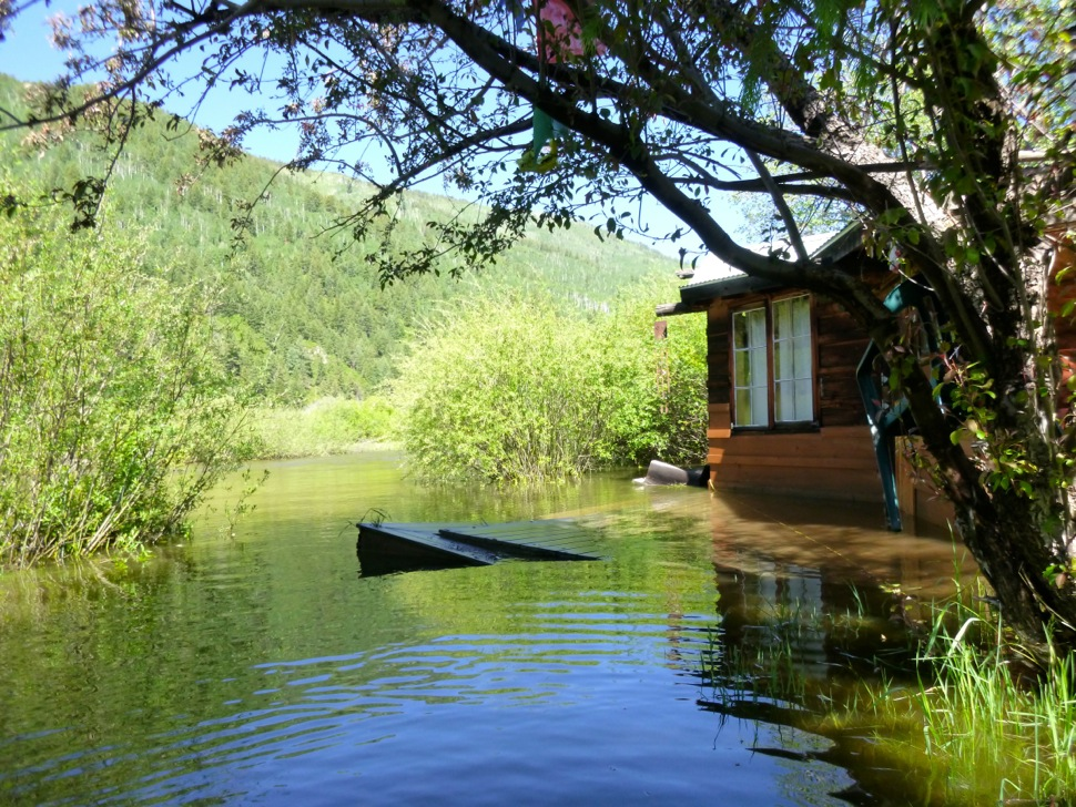 A cabin dating to the mid-1960s in the Stillwater section of the Roaring Fork River was flooded in June 2015, with standing water in the living room and in a nearby art studio.