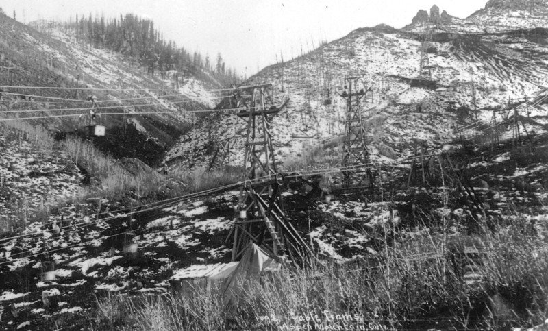 The Aspen Public Tram ascends Little Nell and Niagara circa 1892. The smaller tram ran from the bottom of Little Nell to the Compromise Mine at the top of Nell. What is likely the peaked roof of the first tension station can be seen upper right above today's Kleenex Corner.