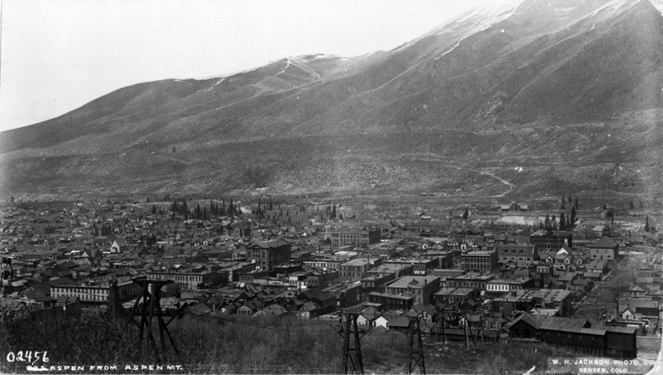 View from Aspen Mountain in 1892 shows Aspen Mountain Public Tramway, and base terminal where The Little Nell hotel is today. The Wheeler Opera House and Hotel Jerome are in the middle. The large building lower left was the Clarendon Hotel in today's Wagner Park.