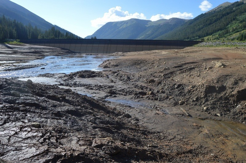 The sediment at the bottom of Grizzly Reservoir has been revealed after the water in the 570 acre-foot reservoir was drained this week after a problem arose with the dam's outlet works. As the reservoir was drained, about 20 acre-feet of muddy water flowed out of the bottom of the reservoir into Lincoln Creek and the Roaring Fork River.