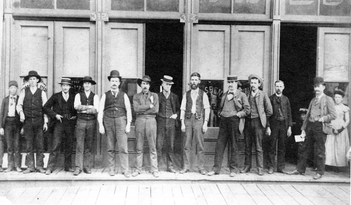 The crew at the Aspen Times stands in front of the newspaper's offices, then on Cooper Ave, in 1890. Photo credit: Aspen Historical Society