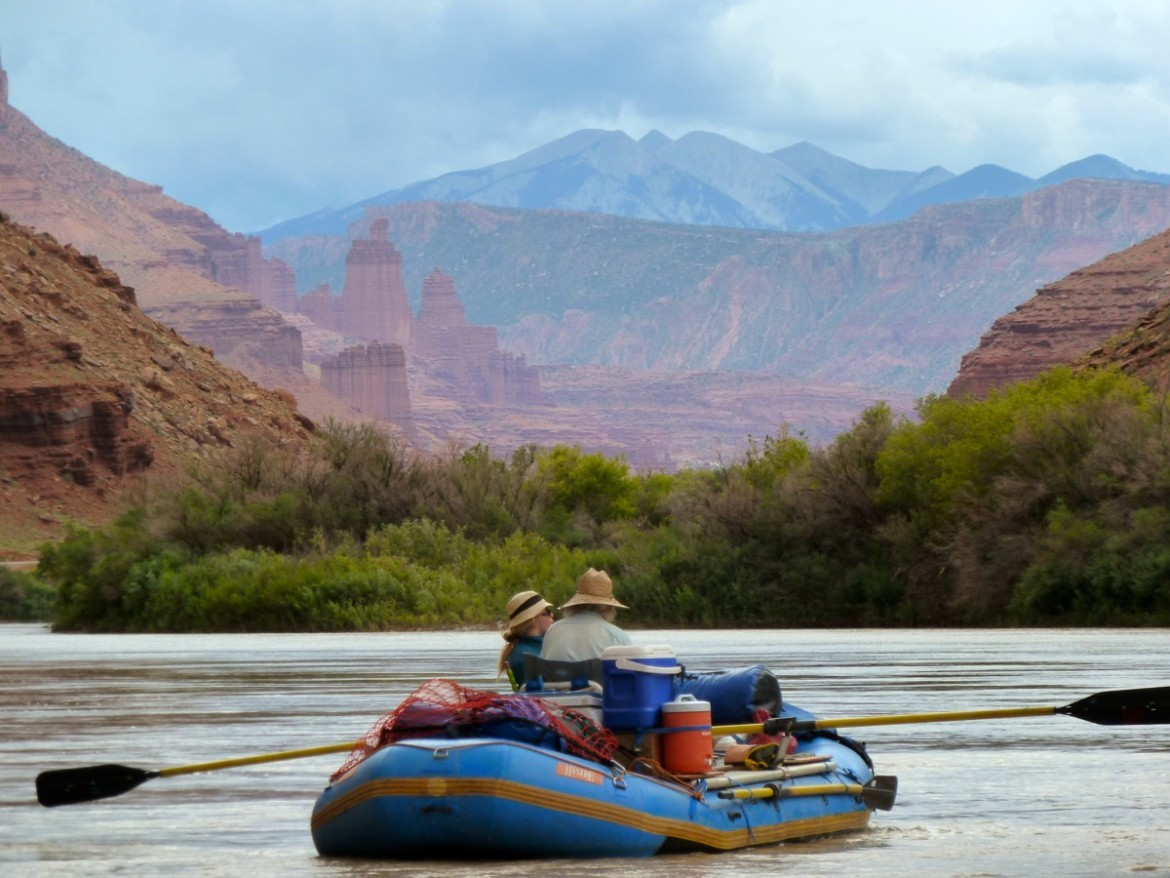 Rafters on the Colorado River approaching Fisher Towers in Utah.