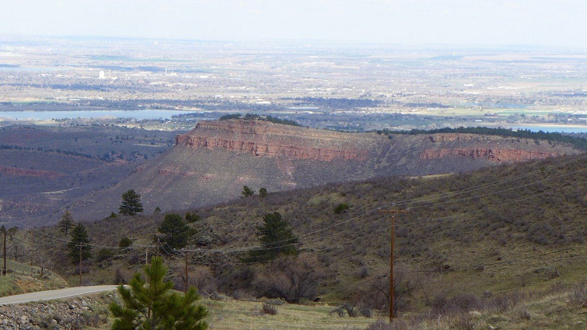 Looking east toward the Chimney Hollow Reservoir site, which is just this side of the red ridge. On the other side is Carter Lake Reservoir and beyond that, the Loveland area.