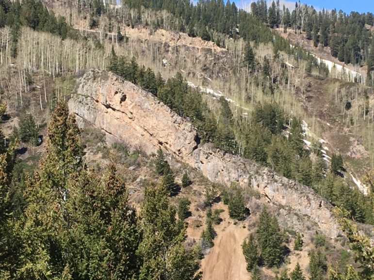 The controversial apex vein of the upper Durant mine is just below the lower horizontal crack on the left side of the rock wall uphill of the Bonny Bell mine dump. It is now covered over with a steel mesh.