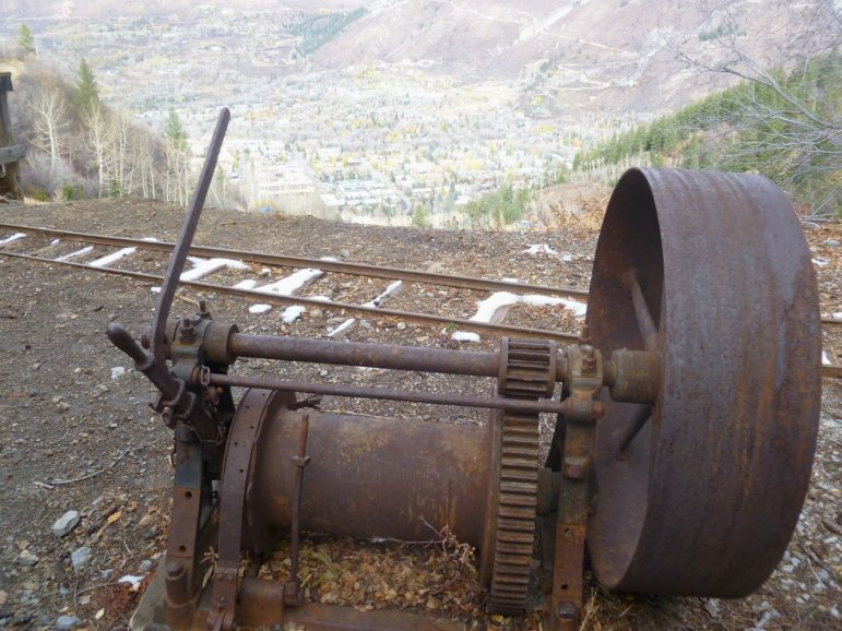 An old hoist outside of the Compromise Mine tunnel overlooking Aspen.