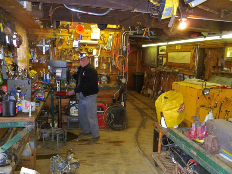 Miner Jay Parker works the drill in the Compromise mine shop inside the Compromise building at the top of Little Nell ski run.