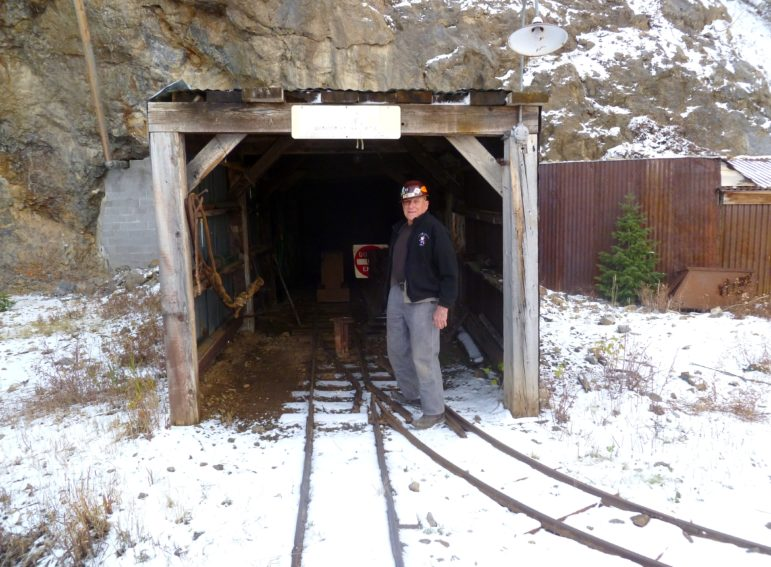 Compromise miner Jay Parker stands in front of the Compromise tunnel, which leads to the complicated underworld of some 14 levels of historical mining exploration with uncountable side drifts, inclines, shafts, winzes, and stopes that followed the ore.