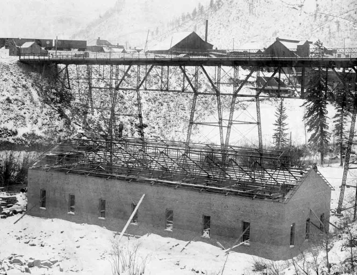 The Castle Creek hydroelectric power house under construction in 1892. The building, under the Castle Creek bridge, is still in use today as a city shop.