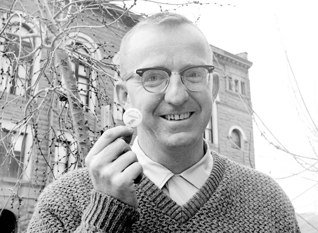 John Kerrigan, the Aspen city manager, or administrator, in 1965. He appears to be standing outside of the Wheeler Opera House and holding a button that says, for some reason, There is no Aspen.