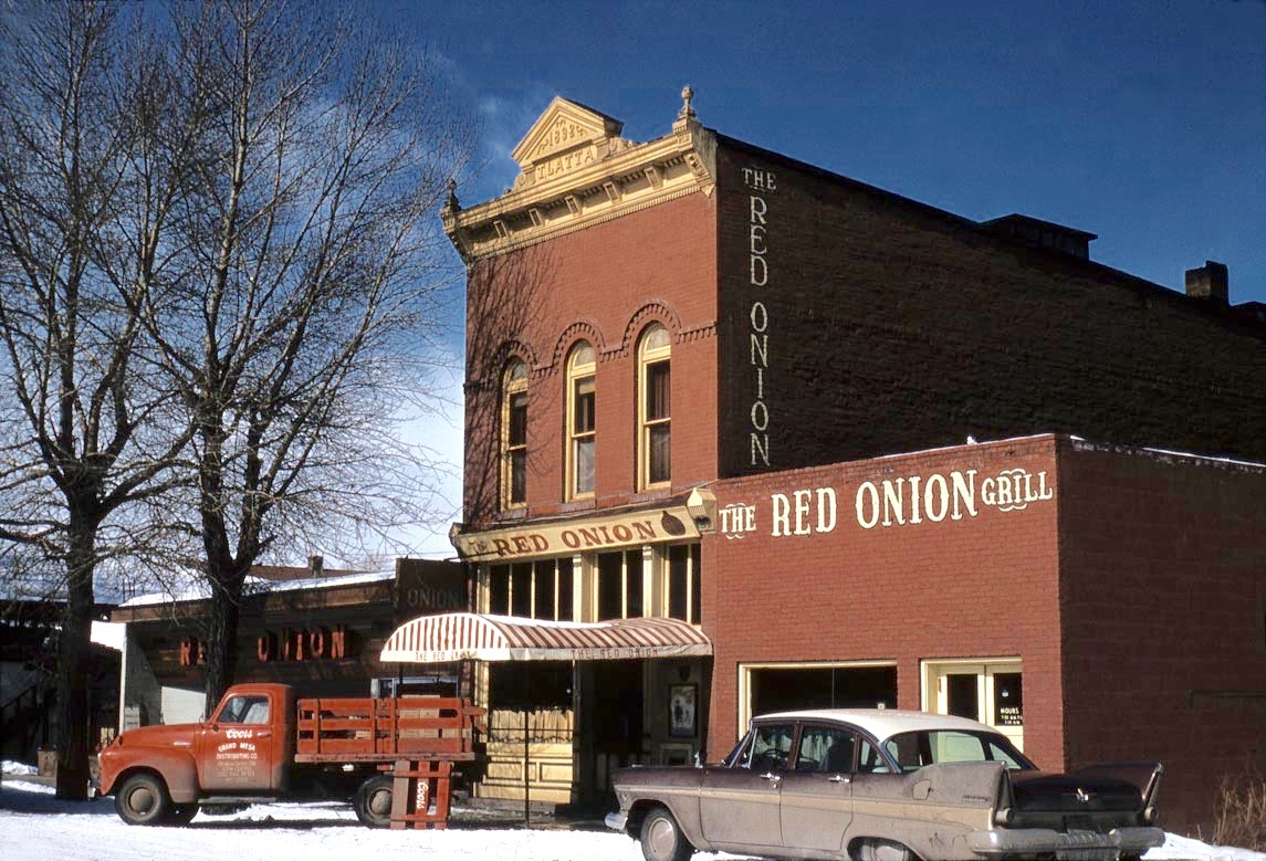 The famous Red Onion in February, 1958, when cars could still park in front of the bar and restaurant. The delivery truck is likely delivering Coors, according to the logo on the front door.