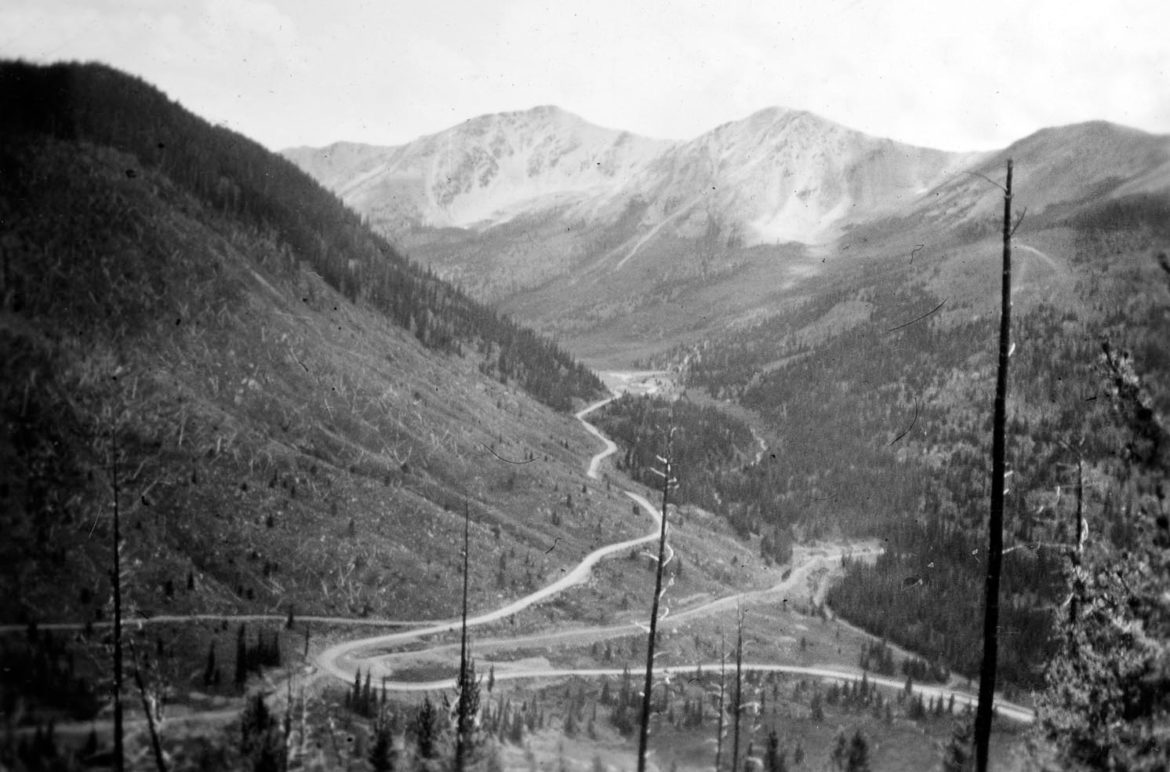 A photo, circa 1940, of the road up Independence Pass and the diversion ditch, running horizontally, that moves water from Lost Man Lake to a diversion under Green Mountain as part of the Twin Lakes - Independence Pass transmountain diversion system.