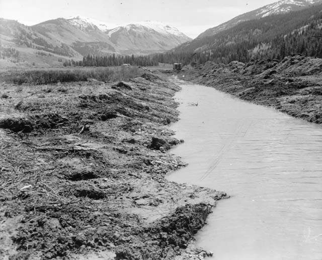What appears to be a recently dug channel full of water from the once winding Eagle River.