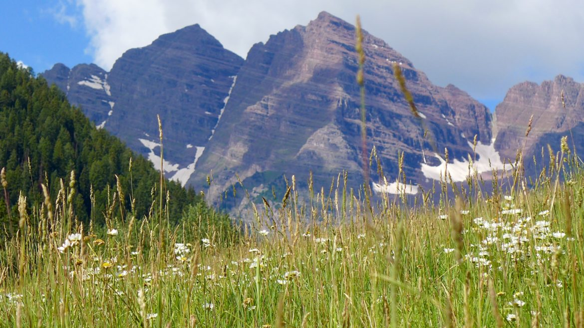 A view of the Maroon Bells, through a zoom lens, from the meadow that would be flooded by a potential 155-foot-tall dam on Maroon Creek. The city of Aspen voted Monday to tell the state this month it still intends to build such a dam - someday - if necessary.