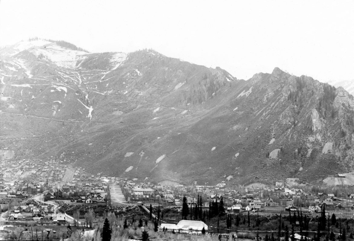 The Silver Queen rests on Aspen Mountain in this 1895 photo. The wide street in the middle of town is Center Street (now Garmisch Street), which points directly toward a good viewing spot of the Queen from Red Mountain. Aspen Street is to the left of Center Street.