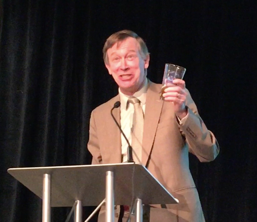 Gov. Hickenlooper, raising a glass of beer to toast to Colorado while speaking on Jan. 25 at the Colorado Water Congress at the Hyatt Regency hotel.