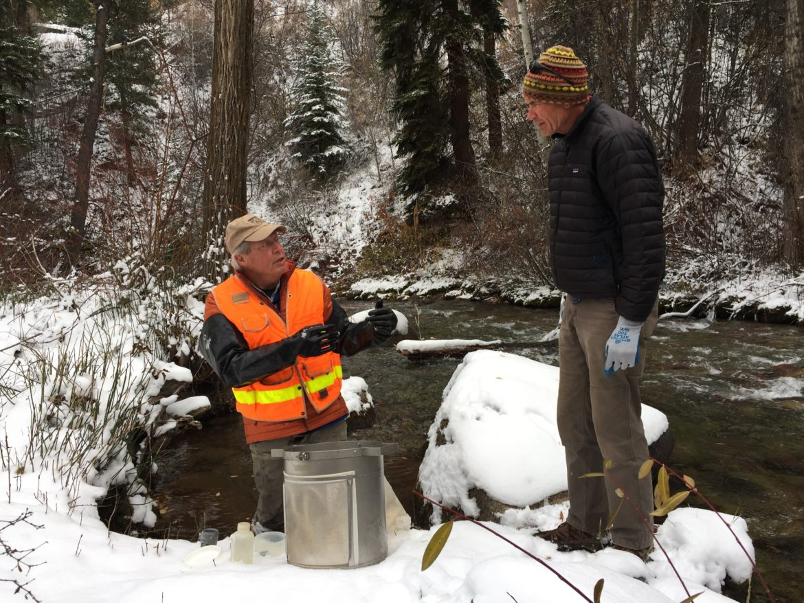 Aquatic ecologist Bill Miller, left, and chair of the Pitkin County Healthy Streams Board Andre Wille stand on the banks of Castle Creek as Miller prepares to take macro-invertebrate samples. The county hired Miller to collect baseline data to ensure increased snowmaking on Aspen Mountain won't harm the health of the stream. Photo by Heather Sackett/Aspen Journalism